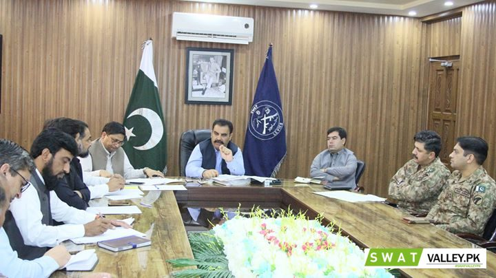 DC Swat Mr. Saqib Raza Aslam chairing meeting in conference hall of the DC office regarding arrangem