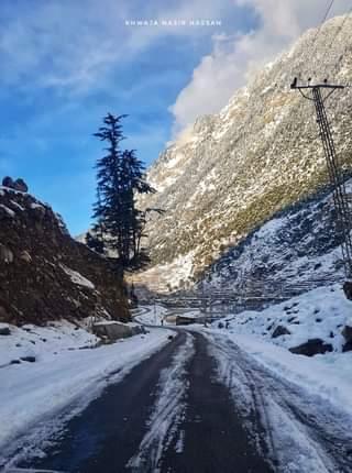 May be an image of tree, snow, nature, road and text that says 'KHWAJA NASIR'
