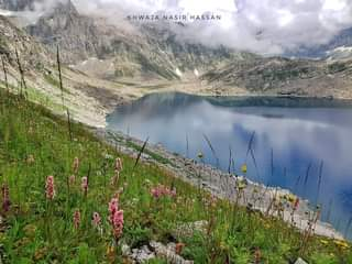 May be an image of nature, lake and text that says 'KHWAJA NASIR HASSAN'