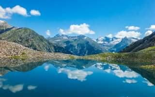 May be an image of mountain, sky, nature and lake